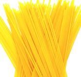 Pasta. Dry italian linguine noodles on white background Stock Image
