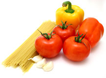 Pasta. Tomatoes, bell peppers and garlic over a white surface Stock Photo