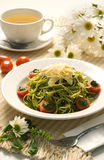 Pasta. Green spaghetti pasta with tomato and cheese Royalty Free Stock Photo