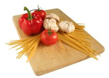 Pasta 6. Fetuccini and ingredients on a cutting board Royalty Free Stock Image