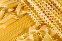 Pasta. Raw delicious spaghetti pasta mix, also background Stock Photography