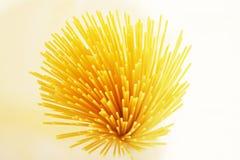 Pasta. Yellow healthy pasta on white background Royalty Free Stock Image