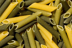 Pasta. Italian raw pasta of colors in a plate Royalty Free Stock Photos
