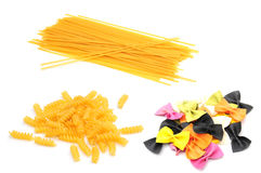 Pasta. Shot of some colourful raw pasta on white Royalty Free Stock Photos