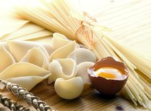 Pasta. Some kind of pasta and open egg at the desk Stock Photography