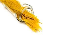 Pasta abstract glass jar spilling speghetti Stock Photos