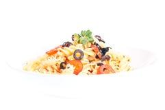 Pasta aglio olio in a pasta plate Stock Images