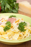 Pasta Alfredo with bacon and prosciutto Royalty Free Stock Photo