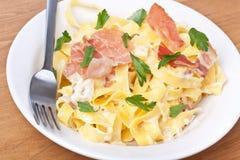 Pasta Alfredo with bacon and prosciutto Royalty Free Stock Photos