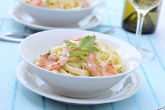 Pasta Alfredo with grilled shrimps Stock Photography