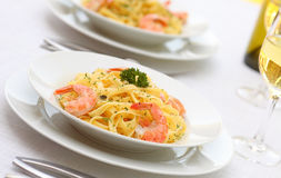 Pasta Alfredo with grilled shrimps Royalty Free Stock Photo