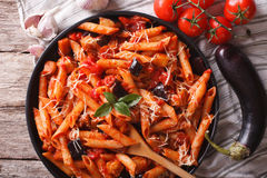 Pasta alla Norma close-up and ingredients. horizontal top view Royalty Free Stock Photos