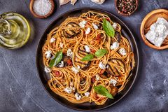 Pasta alla Norma - traditional Italian food. With eggplant, tomato, cheese and basil, top view royalty free stock image