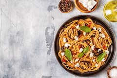 Pasta alla Norma - traditional Italian food. With eggplant, tomato, cheese and basil, top view royalty free stock photography