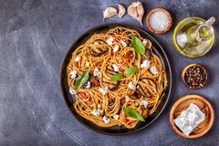 Pasta alla Norma - traditional Italian food. With eggplant, tomato, cheese and basil, top view royalty free stock photos