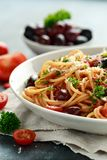 Pasta Alla Puttanesca with garlic, olives, capers, tomato and anchois fish.  royalty free stock photography