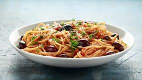 Pasta Alla Puttanesca with garlic, olives, capers, tomato and anchois fish.  stock photo
