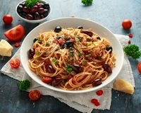 Pasta Alla Puttanesca with garlic, olives, capers, tomato and anchois fish.  royalty free stock photo