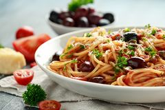 Pasta Alla Puttanesca with garlic, olives, capers, tomato and anchois fish.  royalty free stock images
