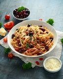 Pasta Alla Puttanesca with garlic, olives, capers, tomato and anchois fish.  royalty free stock photos