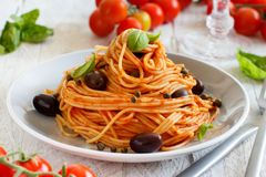 Spaghetti with tomato sauce olives and capers royalty free stock image