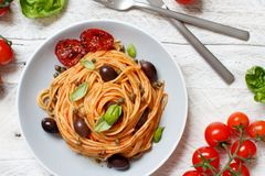 Spaghetti with tomato sauce olives and capers royalty free stock photography