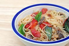 Pasta with Anchovies. Basil, tomatoes and garlic Stock Images