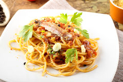 Pasta with anchovies and tomatoes Royalty Free Stock Image