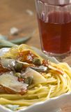 Pasta with anchovis and capers Royalty Free Stock Images