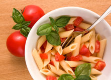 Pasta And Fresh Tomatoes Stock Photography