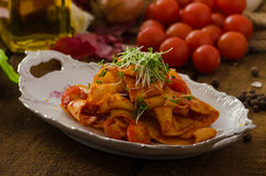 Pasta arrabiata with chilli and garlic organic Royalty Free Stock Images