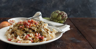 Pasta with artichokes and bacon Stock Image