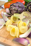 Pasta with artichokes Stock Images