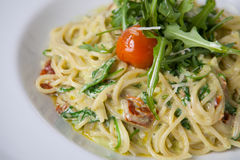 Pasta with arugula and parmesan Royalty Free Stock Photography