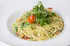 Pasta with arugula and parmesan Royalty Free Stock Images