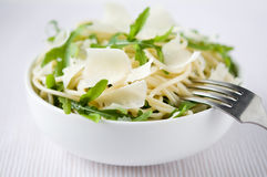Pasta with arugula and parmesan Stock Photo