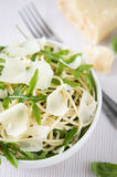 Pasta with arugula and parmesan Stock Image
