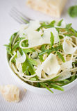 Pasta with arugula and parmesan Stock Photography