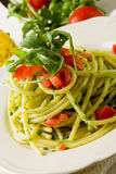 Pasta with arugula pesto and cherry tomatoes Stock Image
