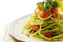 Pasta with arugula pesto and cherry tomatoes Stock Photos