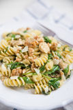 Pasta with arugula and walnuts Stock Images