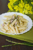 Pasta with asparagus. Spring pasta with asparagus and ham Royalty Free Stock Photography