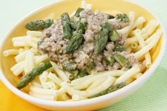 Pasta with asparagus and meat Stock Image