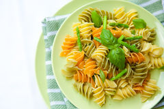 Pasta with asparagus, rocket pesto and basil Royalty Free Stock Photo