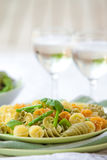 Pasta with asparagus served on outdoor dining Stock Photos