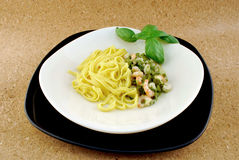Pasta with asparagus and shrimp Stock Image