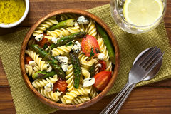 Pasta with Asparagus and Tomato stock photo