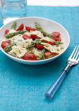 Pasta with asparagus and tomatoes royalty free stock photography