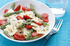 Pasta with asparagus and tomatoes Stock Image