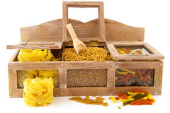 Pasta assortment. In old wooden shop shelf isolated over white Royalty Free Stock Photos